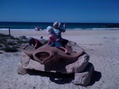 It's hands on art: kids sit on the sandstone stingray sculpture, Swoop, by Daniel Gill.