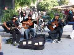 Spanish musicians play for locals in Brisbane